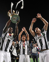 Calcio, finale Tim Cup: Milan vs Juventus. Roma, stadio Olimpico, 21 maggio 2016.<br /> Juventus' Paul Pogba, left, flanked by teammates Paulo Dybala, center, and Leonardo Bonucci, holds up the trophy at the end of the Italian Cup final football match between AC Milan and Juventus at Rome's Olympic stadium, 21 May 2016. Juventus won 1-0 in the extra time.<br /> UPDATE IMAGES PRESS/Isabella Bonotto
