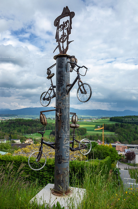 Switzerland. Canton Fribourg. Neyruz. A metal sculpture by the artist Xavier Vimal. The art piece is dedicated to the artist Jean Tinguely, who is buried in the village. A portait and bicycles. Jean Tinguely (22 May 1925 – 30 August 1991) was a Swiss sculptor. He is best known for his sculptural machines or kinetic art, in the Dada tradition; known officially as metamechanics. Tinguely's art satirized the mindless overproduction of material goods in advanced industrial society. 21.05.2019 © 2019 Didier Ruef