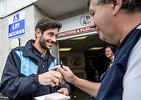 Joe Jacobson of Wycombe Wanderers arrives and signs an autograph for a fan prior to the Sky Bet League 2 match between Crawley Town and Wycombe Wanderers at Checkatrade.com Stadium, Crawley, England on 29 August 2015. Photo by Liam McAvoy.