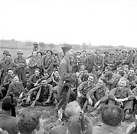Pfc. Mickey Rooney imitates some Hollywood actors for an audience of Infrantrymen of the 44th Division.  Rooney is a member of a three-man unit making a jeep tour to entertain the troops.  Kist, Germany, April 13, 1945. T5c. Louis Weintraub. (Army)<br /> NARA FILE #:  111-SC-203412<br /> WAR & CONFLICT #:  902