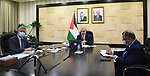 Palestinian Prime Minister Mohammad Ishtayeh, chairs the weekly meeting of his government, via a video link in the West Bank city of Ramallah, on March 15, 2021. Photo by Prime Minister Office