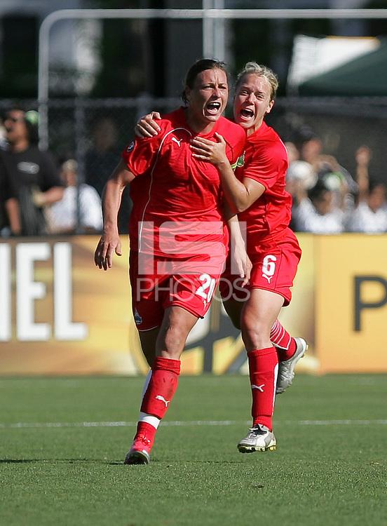 Abby Wambach (20) and Lori Lindsey (6). Washington Freedom defeated FC Gold Pride 4-3 at Buck Shaw Stadium in Santa Clara, California on April 26, 2009.