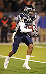 Nevada Wolf Pack quarterback Colin Kaepernick rushes during the first quarter against Boise State in Reno.(AP Photo/Cathleen Allison)