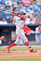 Lakewood BlueClaws third baseman Raul Rivas (15) swings at a pitch during a game against the Beer City Tourists at McCormick Field on June 1, 2017 in Asheville, North Carolina. The Tourists defeated the BlueClaws 8-5. (Tony Farlow/Four Seam Images)