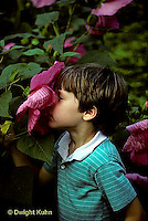 FA01-037z  Child smelling flower