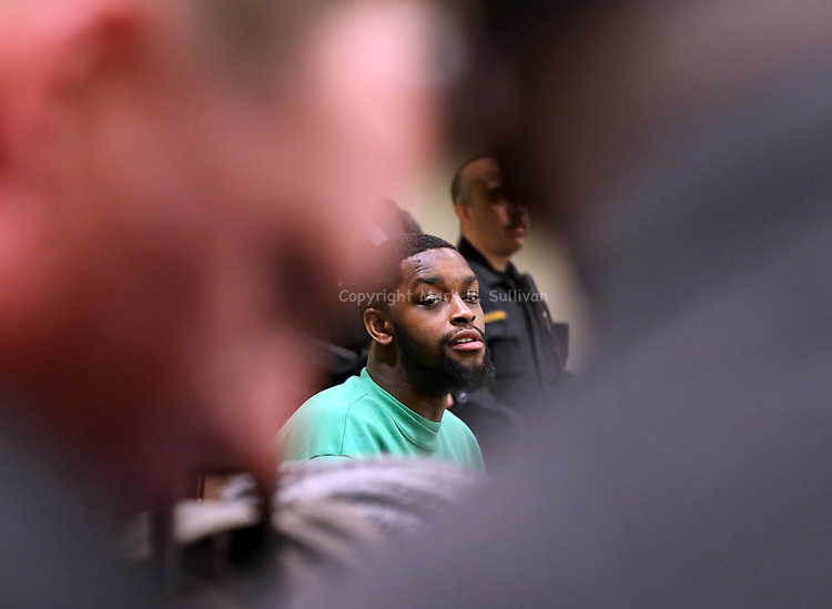Indicted ex-Rutgers football players plead not guilty in home invasions, assault at the Middlesex County Court in New Brunswick on Wednesday January 6, 2015.<br /> Former Rutgers football player Tejay Johnson (center) listens during the court proceedings.