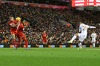 The shot by Jefferson Montero appears to hit the hand of Jordan Henderson during the Barclays Premier League Match between Liverpool and Swansea City played at Anfield, Liverpool on 29th November 2015
