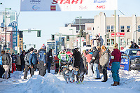 Kristin Bacon and team leave the ceremonial start line with an Iditarider and handler at 4th Avenue and D street in downtown Anchorage, Alaska on Saturday March 4th during the 2017 Iditarod race. Photo © 2017 by Brendan Smith/SchultzPhoto.com.