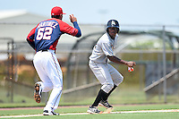 GCL Marlins outfielder Stone Garrett (22) in a rundown with pitcher Anderson Martinez (62) during a game against the GCL Nationals on June 28, 2014 at the Carl Barger Training Complex in Viera, Florida.  GCL Nationals defeated the GCL Marlins 5-0.  (Mike Janes/Four Seam Images)