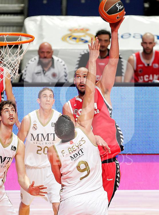 Real Madrid's Felipe Reyes (b) and UCAM Murcia's James Augustine during Liga Endesa ACB match.April 1,2012. (ALTERPHOTOS/Acero)