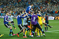 Maxi Rodriguez of Argentina celebrate scoring the winning penalty with Goalkeeper Sergio Romero and team mates