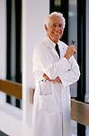 portrait of doctor standing in hospital corridor