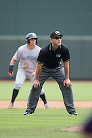 Umpire Brock Ballou handles the calls on the bases during the Carolina League game between the Wilmington Blue Rocks and the Winston-Salem Dash at BB&T Ballpark on June 5, 2016 in Winston-Salem, North Carolina.  The Blue Rocks defeated the Dash 6-2 in the completion of the game suspended on June 4, 2016.   (Brian Westerholt/Four Seam Images)