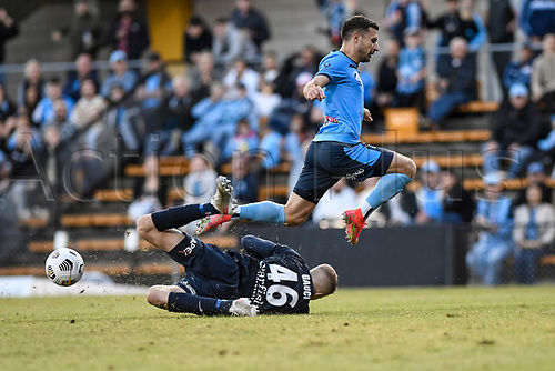 18th April 2021; Leichardt Oval, Sydney, New South Wales, Australia; A League Football, Sydney Football Club versus Adelaide United; Joe Gauci of Adelaide United saves at the feet of Kosta Barbarouses of Sydney only for the ball to fall to Bobo who scored for 2-0 in the 51st minute