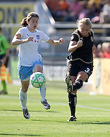 Marisa Abegg (3) kicks the ball down field, pursued by Karen Carney (14). FC Gold Pride and Chicago Red Stars tied 1-1 at Buck Shaw Stadium in Santa Clara, California on June 7, 2009.
