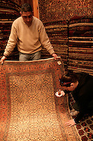 Haggling over a carpet while drinking tea at the Grand Bazaar, Istanbul, Turkey