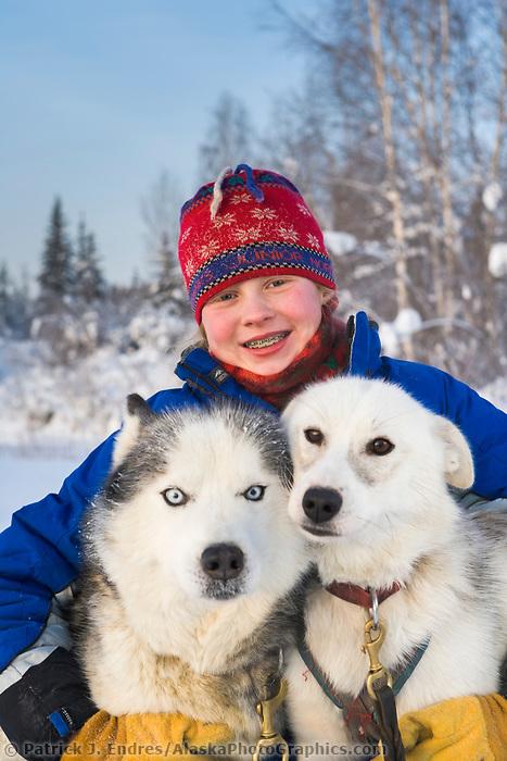McKenzie Brooks holds here sled dogs, Junior Iditarod musher in 2005, Fox, Alaska