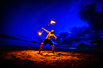 Sean Chadwell twirls a flaming torch at Shell Point Beach in Wakulla County Florida in the north Florida panhandle.
