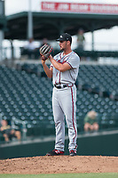 Peoria Javelinas relief pitcher Kyle Muller (22), of the Atlanta Braves organization, looks in for the sign during an Arizona Fall League game against the Mesa Solar Sox at Sloan Park on October 11, 2018 in Mesa, Arizona. Mesa defeated Peoria 10-9. (Zachary Lucy/Four Seam Images)