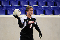 Colin Rolfe (9) of the Louisville Cardinals. Connecticut defeated Louisville 1-0 during the first semifinal match of the Big East Men's Soccer Championships at Red Bull Arena in Harrison, NJ, on November 11, 2011.