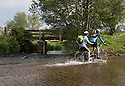 05/06/15<br /> <br /> Daisy Daisy...  Chris and Nicky Smith choose not to use the bridge over Bradbourne Brook and instead splash through Tissington Ford on their tandem as the summer weather continues to heat up near Ashbourne, in the Derbyshire Peak District.<br /> <br /> All Rights Reserved: F Stop Press Ltd. +44(0)1335 418629   www.fstoppress.com.