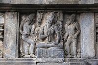 Yogyakarta, Java, Indonesia.  Prambanan Temples.  Servant and Guard of Shiva, Wall Relief Carving.