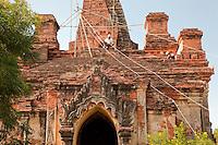 Myanmar, Burma.  Manuha Temple, Bagan, 11th. Century.  Repair Work in Progress.