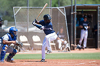 AZL Padres 1 shortstop Ruddy Giron (4) at bat in front of catcher Stephan Vidal (13) during an Arizona League game against the AZL Royals at Peoria Sports Complex on July 4, 2018 in Peoria, Arizona. The AZL Royals defeated the AZL Padres 1 5-4. (Zachary Lucy/Four Seam Images)