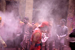 Boys trow gulal at each other on a street during Holi Festival in Vrindavan. Holi - The  Hindu festival of colour is celibrated for a week in the Brraj region of Uttar Pradesh, India.