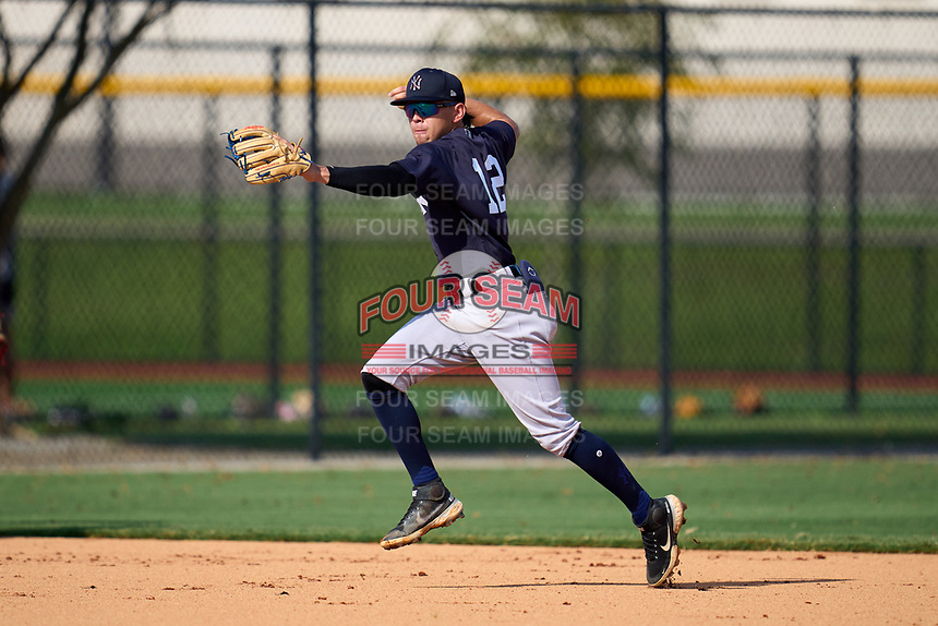 FCL Yankees shortstop Jose Colmenares (12) during practice before a game against the FCL Tigers West on July 31, 2021 at Tigertown in Lakeland, Florida.  (Mike Janes/Four Seam Images)