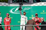 Mercedes driver Lewis Hamilton (44) of Great Britain, Ferrari driver Kimi Raikkonen (7) of Finland and Ferrari driver Sebastian Vettel (5) of Germany on the podium after the Formula 1 United States Grand Prix race at the Circuit of the Americas race track in Austin,Texas.