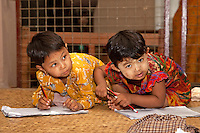 Myanmar, Burma. Bagan.  Young Burmese Girls Writing in their Notebooks.  They have thanaka paste, a cosmetic sunscreen, on their  faces.