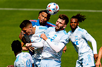 LOS ANGELES, CA - MAY 29: Tristan Blackmon #27 of LAFC battles with Alexander Callens #6 of NYCFC during a game between New York City FC and Los Angeles FC at Banc of California Stadium on May 29, 2021 in Los Angeles, California.