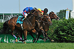 Keertana and Jose Lezcano (black cap) take the 74th running of the G3 Louisville Handicap at Churchill Downs in Louisville, Kentucky on Saturday May 28, 2011. Keertana is the first female to defeat males in the Louisville handicap.