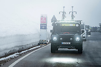 A Team Ineos Grenadiers Grenadier support car coming down the misty Passo Giau<br /> <br /> due to the bad weather conditions the stage was shortened (on the raceday) to 153km and the Passo Giau became this years Cima Coppi (highest point of the Giro).<br /> <br /> 104th Giro d'Italia 2021 (2.UWT)<br /> Stage 16 from Sacile to Cortina d'Ampezzo (shortened from 212km to 153km)<br /> <br /> ©kramon