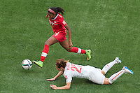 June 21, 2015: Ashley LAWRENCE of Canada runs with the ball during a round of 16 match between Canada and Switzerland at the FIFA Women's World Cup Canada 2015 at BC Place Stadium on 21 June 2015 in Vancouver, Canada. Canada won 1-0. Sydney Low/Asteriskimages.com