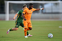 LAKE BUENA VISTA, FL - JULY 18: Darwin Quintero #23 of the Houston Dynamo turns away from pressure during a game between Houston Dynamo and Portland Timbers at ESPN Wide World of Sports on July 18, 2020 in Lake Buena Vista, Florida.
