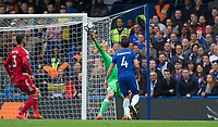Goalkeeper Heurelho Gomes of Watford pulls off a great save from Cesc Fabregas of Chelsea during the Premier League match between Chelsea and Watford at Stamford Bridge, London, England on 21 October 2017. Photo by Andy Rowland.