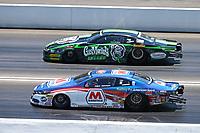 Jun 18, 2017; Bristol, TN, USA; NHRA pro stock driver Allen Johnson (near) races alongside Alex Laughlin during the Thunder Valley Nationals at Bristol Dragway. Mandatory Credit: Mark J. Rebilas-USA TODAY Sports