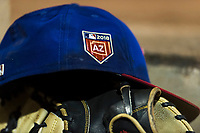 An AZL Rangers hat rests on a glove during an Arizona League game against the AZL Giants Black at Scottsdale Stadium on August 4, 2018 in Scottsdale, Arizona. The AZL Giants Black defeated the AZL Rangers by a score of 6-3 in the second game of a doubleheader. (Zachary Lucy/Four Seam Images)