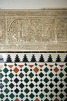 Arabesque Zellighe tiles with Mudjar plasterwork from tyhe vestibule of the Alcazar of Seville, Seville, Spain