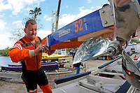 Sean Bowsher Y-52 puts the drain plugs in.  (1 Litre MOD hydroplane(s)