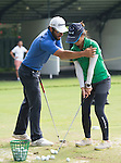 A professional golfer gives a clinic to students on the side of UBS Hong Kong Open golf tournament at the Fanling golf course on 24 October 2015 in Hong Kong, China. Photo by Aitor Alcade / Power Sport Images