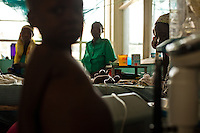 A child recieving oxygen while his family stands vigil in the hospital in Homa Bay, Kenya