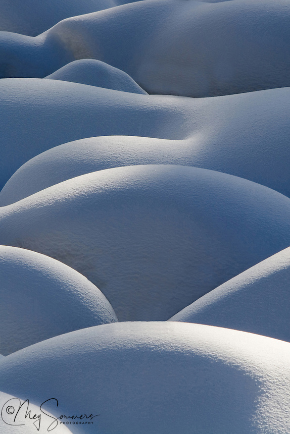 """Snow pillows form on Soda Butte Creek in the NE corner of Yellowstone during the deep winter months.  These """"pillows"""" are really rocks in the stream bed covered with snow. It is the light that makes them really special :)"""