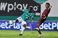 PALMIRA – COLOMBIA, 21-03-2021: Andres Colorado del Cali disputa el balón con John Narvaez del Deportes Tolima durante el partido entre Deportivo Cali y Deportes Tolima por la fecha 13 de la Liga BetPlay DIMAYOR 2021 jugado en el estadio Deportivo Cali de la ciudad de Palmira. / Andres Colorado of Cali vies for the ball with John Narvaez of Deportes Tolima during match between Deportivo Cali and Deportes Tolima for the date 13 as part of BetPlay DIMAYOR League 2021 played at the Deportivo Cali stadium in Palmira city. Photos: VizzorImage / Nelson Ríos / Cont.