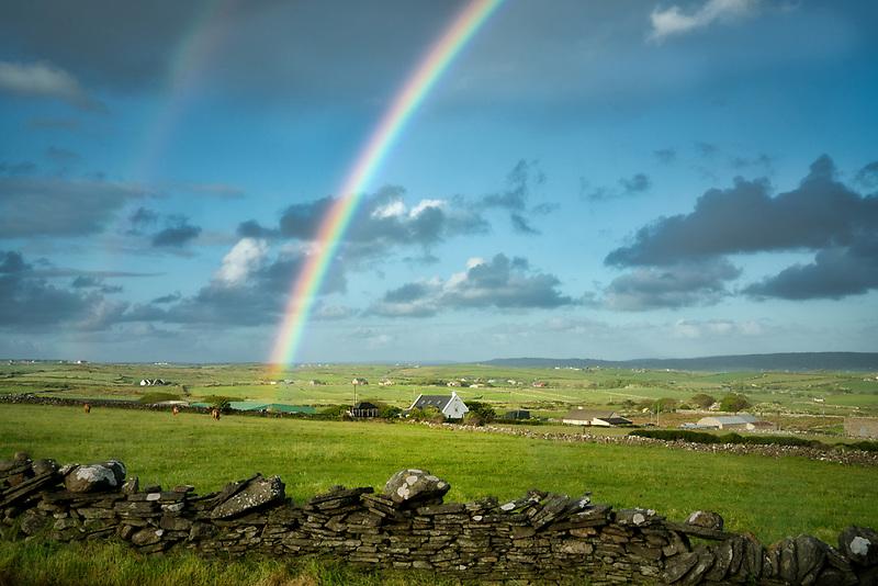 Rainbow over pasture. County Clare, Ireland
