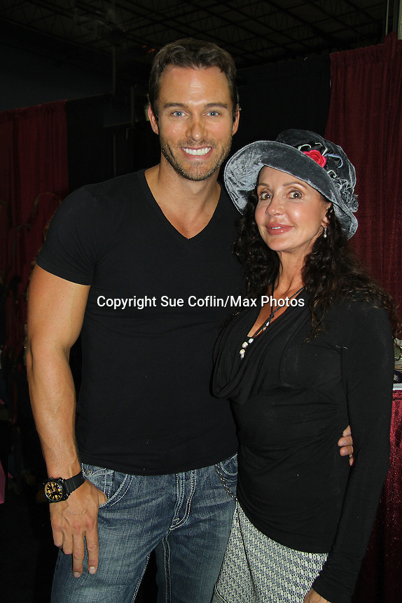 """Days' Eric Martsolf poses with General Hospital's Jackie Zeman wearing Hats for Health as Daytime's TV and Broadway stars get involved in helping launch Jane Elissa's """"Hats For Health"""" to promote awareness and to raise money for Leukemia/Lymphoma cancer research and patient aid. The Hats For Health will be available through Jane Elissa at 917-325-1085 and through the new website """"Hats For Health"""". Jackie Zeman was at the 8th Annual Connecticut Women's Expo presented by Comcast on September 11 & 12, 2010, Hartford, Connecticut.  (Photo by Sue Coflin/Max Photos)"""