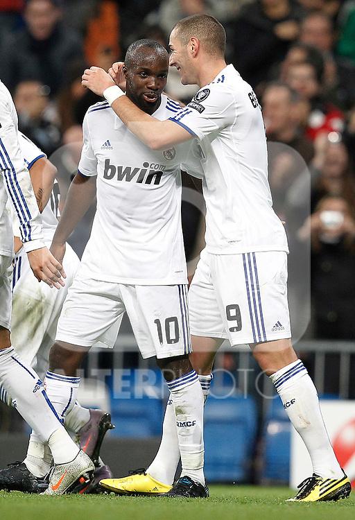 Real Madrid's Karim Benzema (goal)  and Lassana Diarra during Champions League match on december 8th 2010...Photo: Cesar Cebolla / ALFAQUI