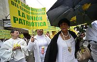 """BOGOTÁ -COLOMBIA. 09-10-2014. Marcha por la """"Dignidad de las Víctimas del Genocidio contra La UP"""" realizada hoy, 9 de octuber de 2014, en el centro de la ciudad de Bogotá./ March for the """"Dignity of Victims of Genocide against The UP"""" took place today, October 9 2014, at downtown of Bogota city. Photo: Reiniciar /VizzorImage/ Gabriel Aponte<br /> NO VENTAS / NO PUBLICIDAD / USO EDITORIAL UNICAMENTE / USO OBLIGATORIO DELCREDITO"""